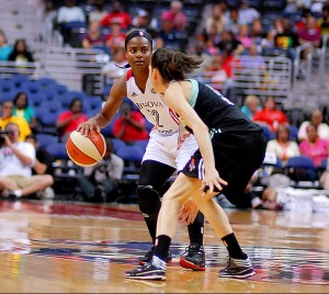 Ivory Latta sets up the Mystics offense while the New York Liberty's Anna Cruz matches up. August 5, 2014. IPhoto credit: Mark Coleman